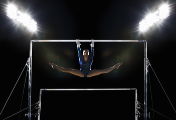 A gymnast on the parallel bars performing a routine