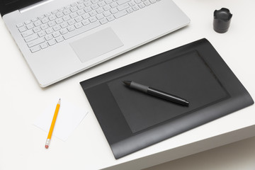 digital drawing tablet and laptop on the table
