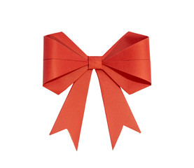 Red ribbon with bow made of paper on a white background