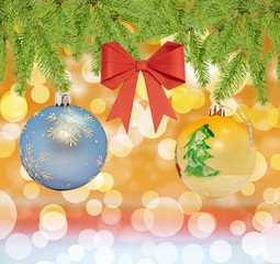Christmas decorative blue and yellow ball with red bow on bokeh