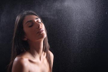 Girl under water spray