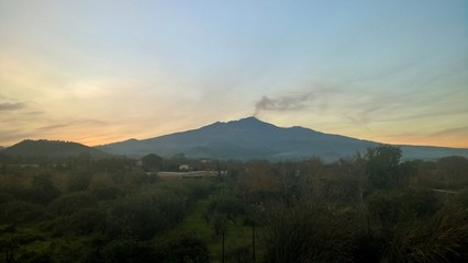 Etna sunset, smoke black ash, Sicily.
