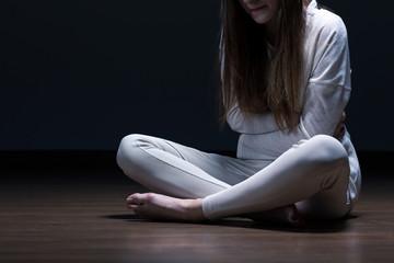 Despair female with mental problem
