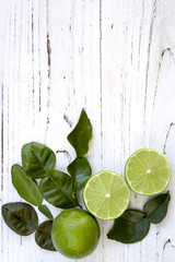 Kaffir Lime Leaves and Fruit Food Background