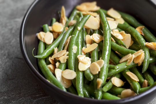 Green Beans with Toasted Almonds in Black Bowl