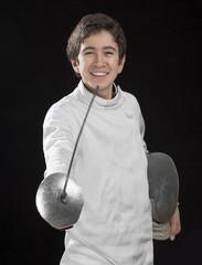 Portrait of a happy foil fencer on black background.