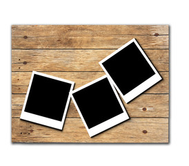 Stock Photo:Polaroid photo frames on old wooden background