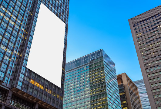 Blank billboard and The high rise business building at night time