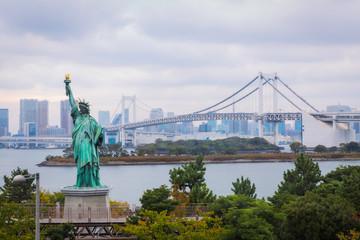 Statue of Liberty and Rainbow Bridge in Tokyo