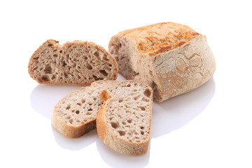 loaf and slices of bread on a white background