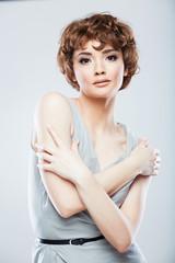 Woman fashion model studio portrait.