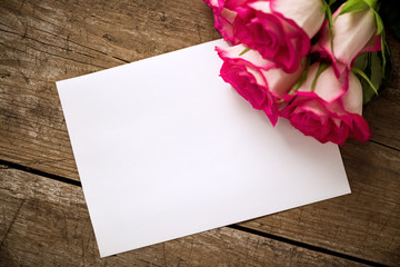 Roses with empty white paper