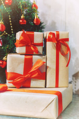 stack of gifts under a Christmas tree