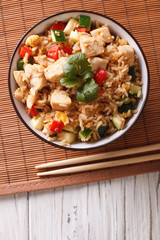 Tyahan - fried rice with chicken and vegetables. vertical top view