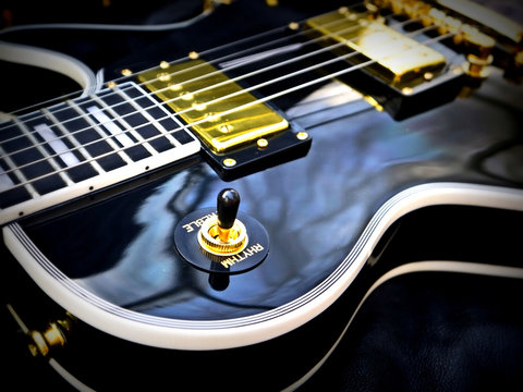 Fashion Electric Les Paul Guitar on Genuine Leather close-up