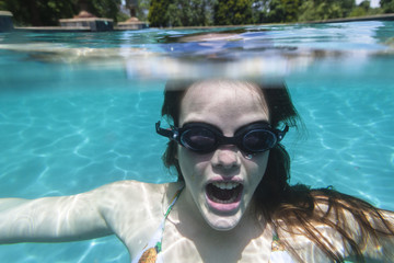 Girl Underwater swimming pool summer fun