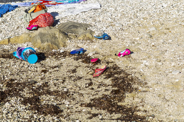 Various fashion discarded on the beach