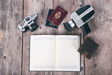 Old fashionable travel stuff on wooden table