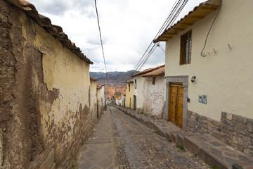 Old narrow street in the center of Cusco Peru