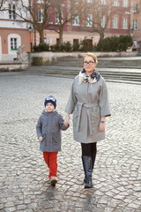 Mother and son at the old European city