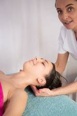 stretching osteopathy procedure in the neck