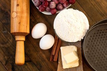 flour, eggs, cherry oil, cinnamon, on a wooden table