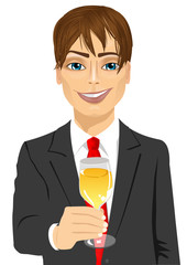young handsome businessman toasting with a glass of champagne