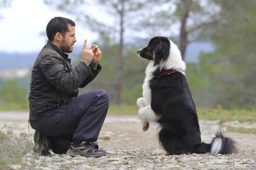 man with an australian shepherd