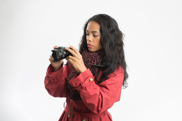 Beautiful woman taking  pictures, with rose raincoat, brown wool