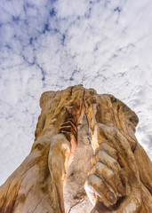 Hands and trunk sculpture in Tordesillas against cloudy sky