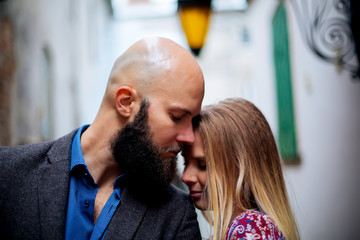 portrait of man and woman up close, beard and bald