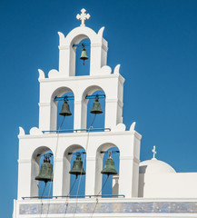 A bell tower at a Greek Orthodox church in Oia town on the island of Santorini