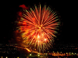 Fireworks on night city background
