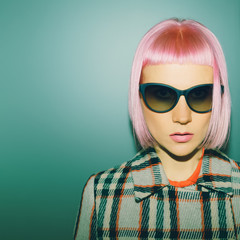 Fashionable lady with pink hair