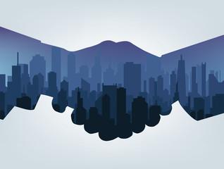 Handshake silhouette. City background