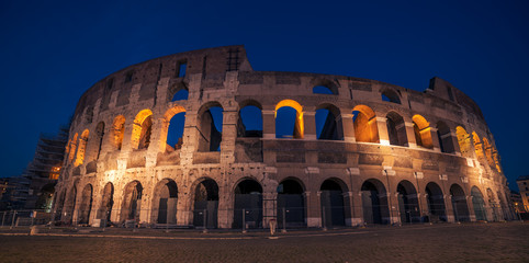 Fototapete - Rome, Italy: Colosseum, Flavian Amphitheatre, in the sunset