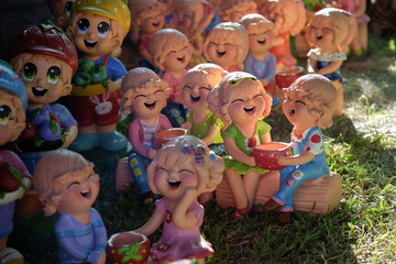 Smiling and laughing clay doll, Happiness concept.