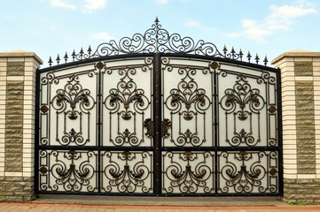 iron gate with wrought ornament on it