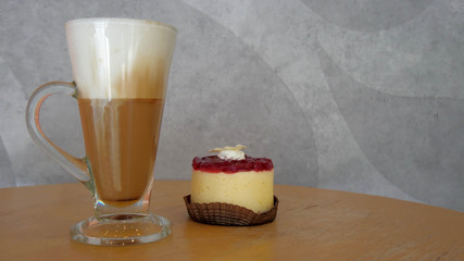 hot coffee cheese cake on wooden table