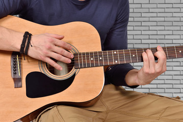 hand playng on acoustic guitar