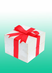 Red bow gift on green background.