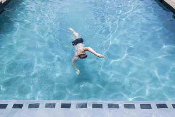 Swimmer training action mature teenager swimming pool