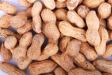 Monkey nuts, peanuts or groundnuts in shells, isolated on a white background