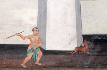 the Ramayana painting on the wall in public temple Wat Phra Kaew in Thailand