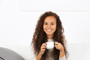 Close up portrait of pretty young woman drinking coffee on white background