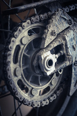 Muddy motorcycle chain