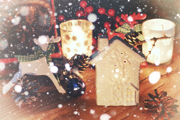 new year snow table with pine cone and candle