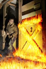 Axe wielding man in a fiery barn
