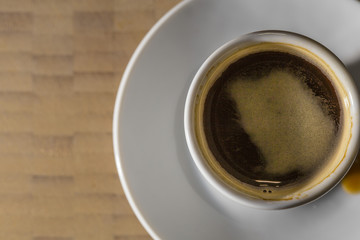 Coffee Espresso on a white plate and wooden background