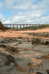 Cape Patterson Kilcunda Victoria Australia cycling trail bridge with tidepool erosion at low tide